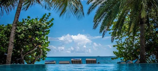Return flights from London to Antigua