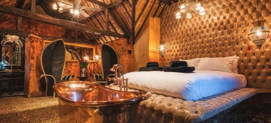 An opulent Crazy Bear stay with Champagne, three course dinner and more
