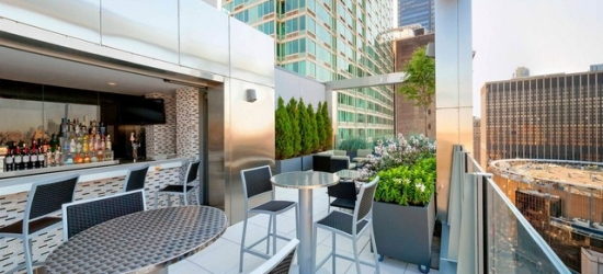 $ Based on 2 people per night | Chic Midtown base with a rooftop bar, Manhattan, New York