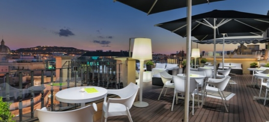 $ Based on 2 people per night | Central Barcelona award-winner with a rooftop bar, H10 Universitat, Barcelona, Spain