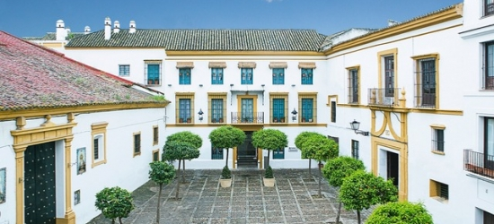 $ Based on 2 people per night | Historic hotel in enchanting Seville, Hospes Las Casas del Rey de Baeza, Spain